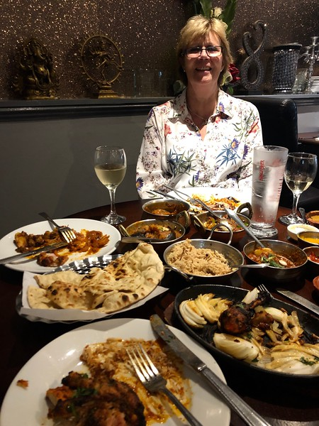 Enjoying Indian cuisine at Delhi's Winter restuarant<br /> Linlithgow, Scotland