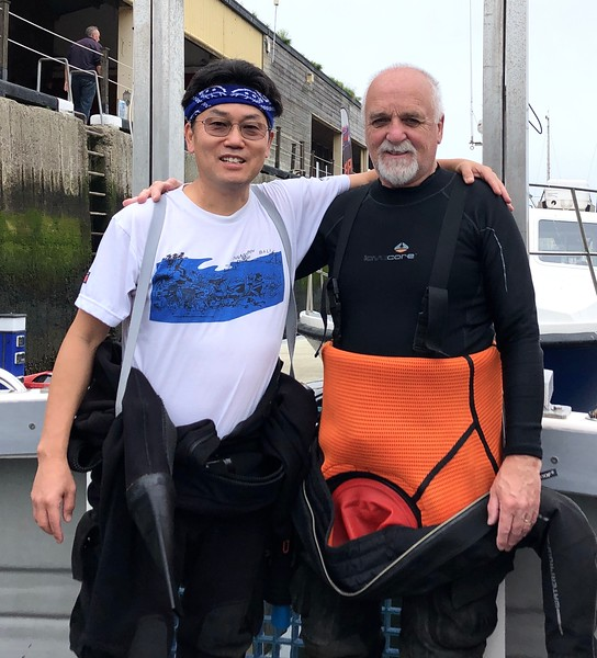 With Jim, ready to dive, near Eyemouth, Scotland.  Yes, that's a diver elevator on the boat!