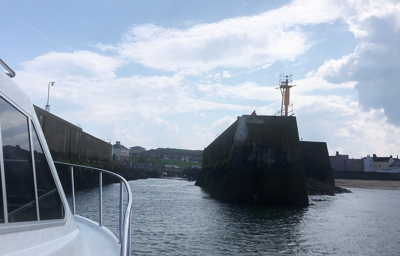Entering narrow Eyemouth Harbor,<br /> Scotland