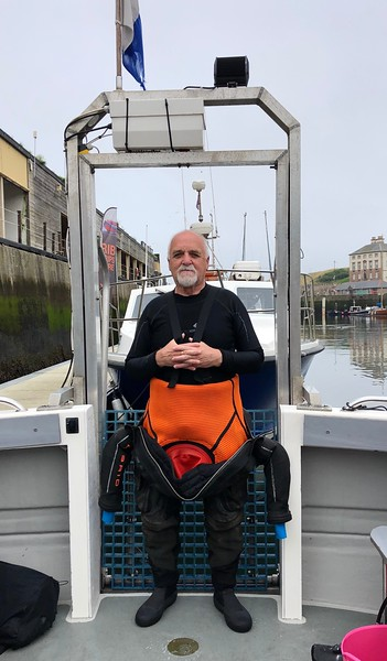 Jim, ready to dive, near Eyemouth, Scotland.  Yes, that's a diver elevator on the boat!