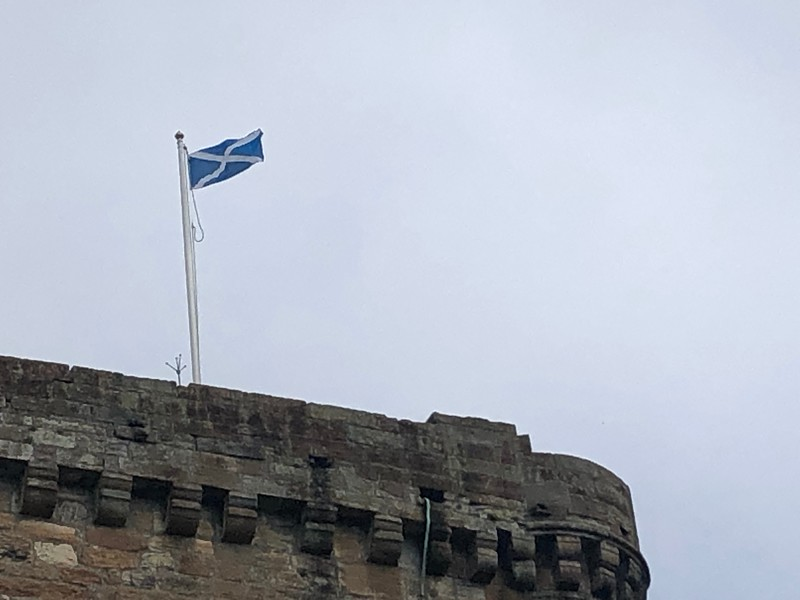 Scottish Flag waving over Linlithgow Palace, Linlithgow, Scotland.