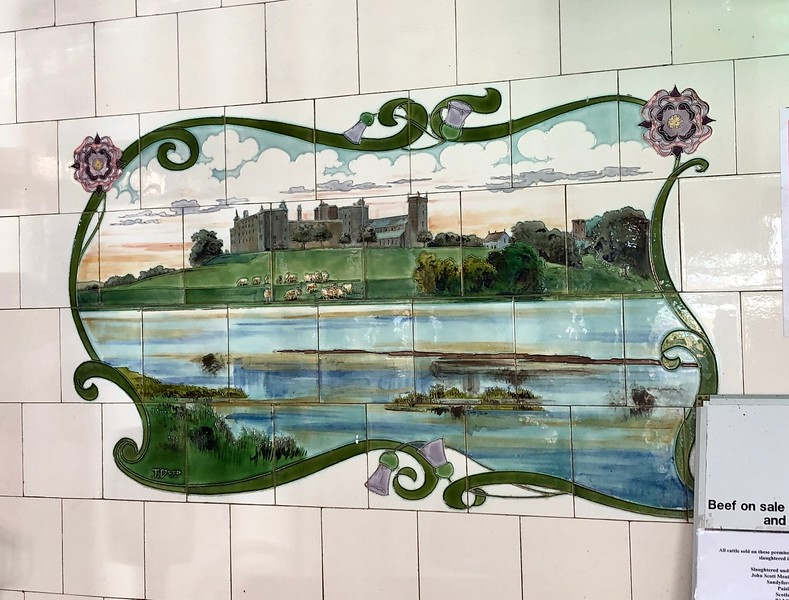 Ceramic tiles in the local TD Anderson butcher shop, founded in 1897.<br /> Linlithgow, Scotland