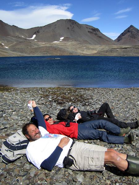 Jeff, Lilian & Nico take a rest, beside a mountain lake, enroute to Stromness.<br /> South Georgia Island