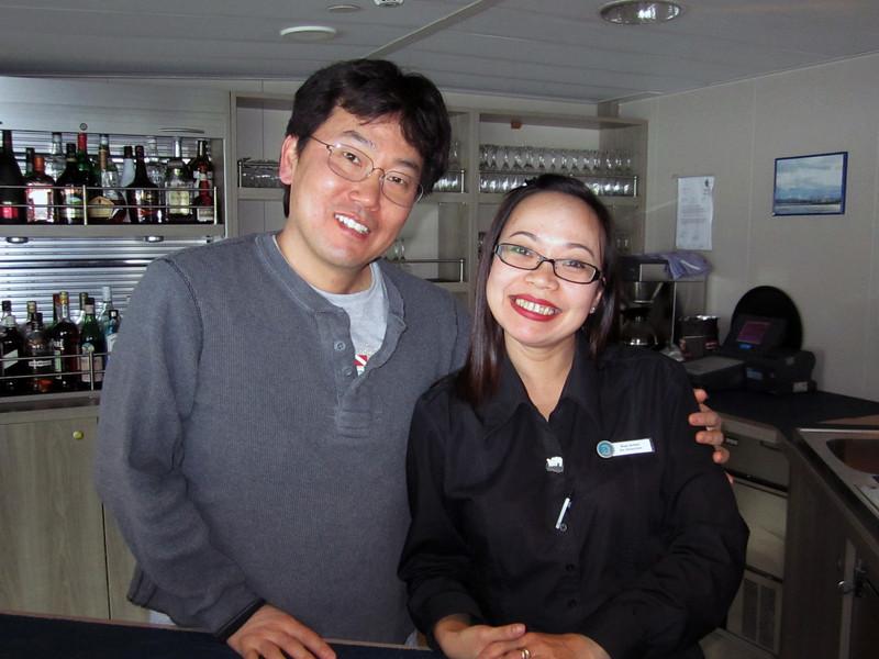 Rosi & Kevin behind bar, aboard the Plancius.<br /> South Georgia Island