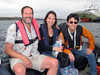 Jeff, Lilian & Kevin, on a zodiac bound for the Plancius.<br /> Port Stanley, East Falkland Island.