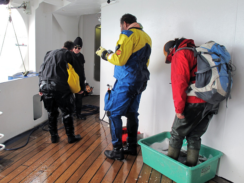 Post dive rinse off.  Hikers are required to disinfect their boots after each land excursion to minimize contamination.<br /> South Georgia Island