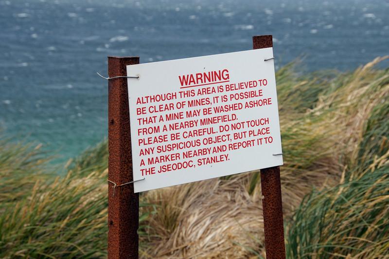 Warning sign advising of possible land mine danger.<br /> East Falkland Island.