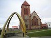 Stanley Cathedral in Stanley, East Falkland Island.  The Whalebone Arch was erected in 1933 from jawbones of the Blue Whale, to commemorate a century of continuous British settlement on the island.