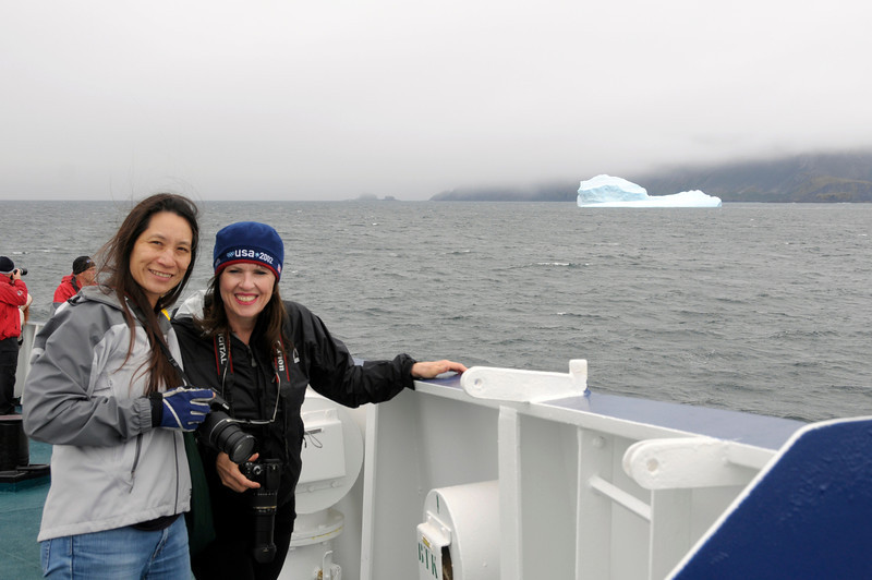Lilian & Susie, enjoying the passing landscape and icebergs.<br /> South Georgia Island