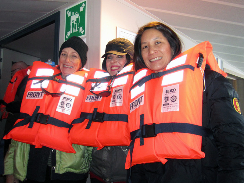 Diane, Susie & Lilian, decked out in life preservers, participating in emergency drill, aboard the Plancius.