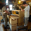 Wicked Local photo by Nicole Goodhue Boyd 081711<br /> Lovell Parsons works with his grandson Alden Burnham, 17, to put together deck boxes Wednesday Aug 17 at Burnham Boat Shop.