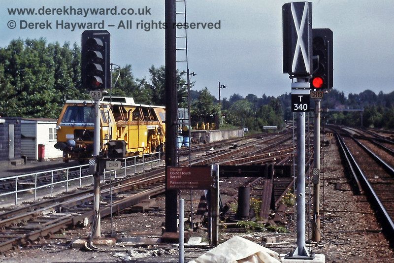 Haywards Heath station on 14.06.1981, during upgrading of the colour light signals.  These are the Up Starting signals, with a new signal (T340) installed but not yet commissioned.  The  white oblong with a black bar below the aspects indicates that it is an automatic signal.  A tamper stands in the Up siding.  Many years before a turntable was sited on the left of the line just beyond the station.  Eric Kemp retains all rights to this image.