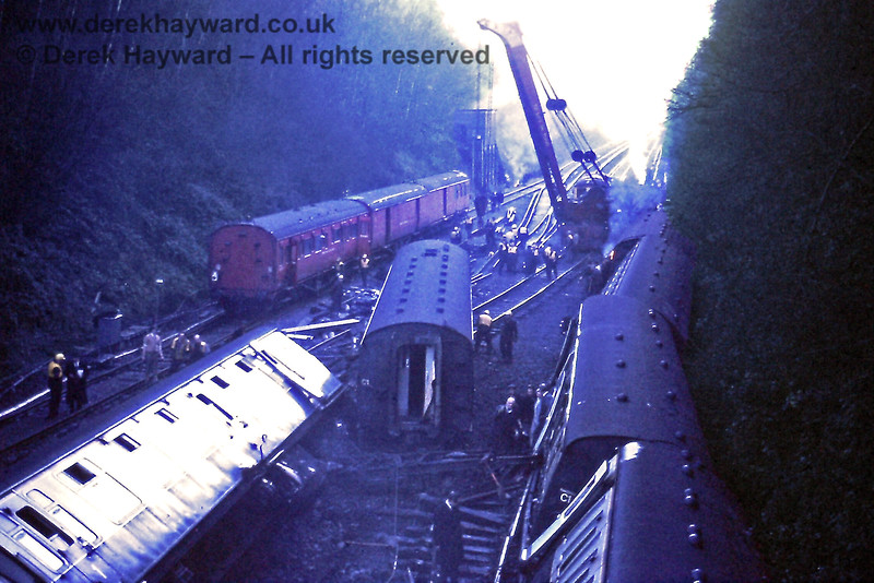 A number of accidents have occurred near Haywards Heath.  This is Copyhold Junction on Monday 18.12.1972 as breakdown trains cleared the wreckage from a collision that occurred on 16 December 1972 when two northbound Victoria trains came together at the point where the Up Through line and Up Local line merged near Copyhold Bridge.  The trains were lightly loaded and although there was extensive damage there were no serious injuries.  The incident was caused by the train on the local line passing a red signal.  This is the view north.  Eric Kemp retains all rights to this image.