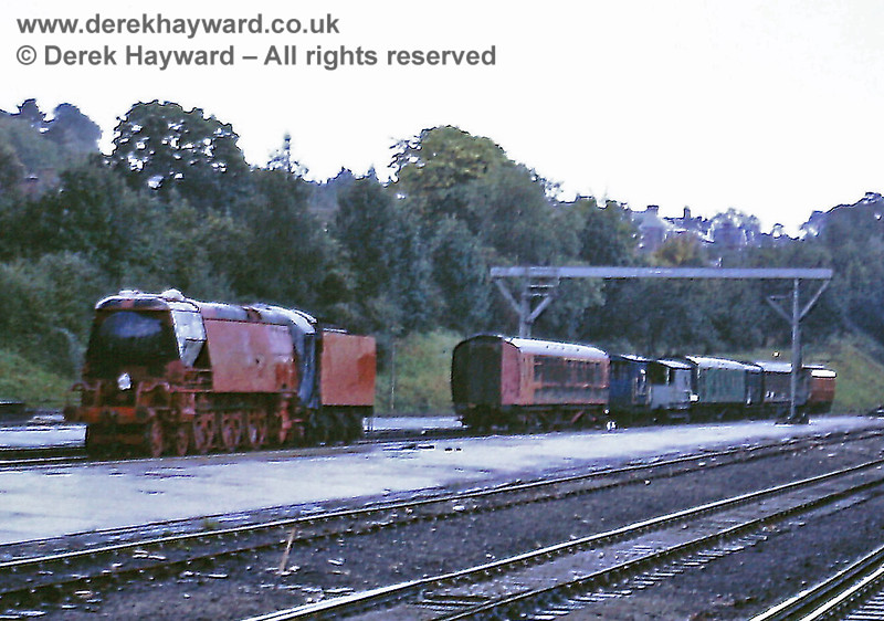 Haywards Heath yard on 27.09.1971, with heritage rolling stock stored awaiting transfer to the Bluebell Railway.  The locomotive is 21C123 Blackmore Vale, in a livery which was fortunately temporary.  Eric Kemp retains all rights to this image.