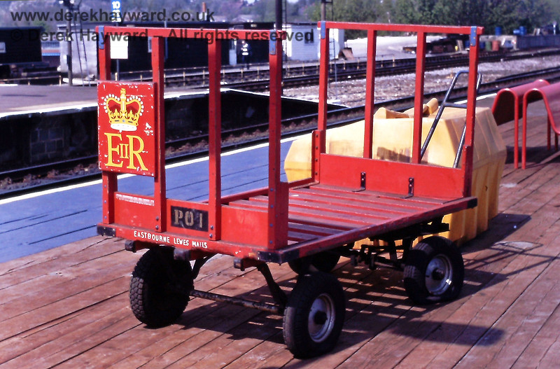"""Who remembers these?  A GPO trolley at Haywards Heath on 26.04.1990, wearing a very prominent """"E:R"""" logo and the legend """"Eastbourne Lewes Mails"""", for which, presumably, it was waiting.  Eric Kemp retains all rights to this image."""