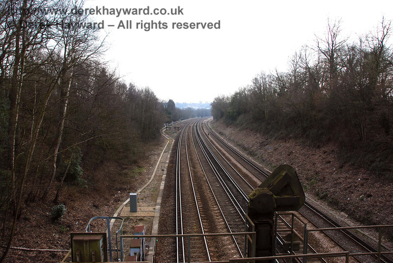 Looking south towards Haywards Heath from the same viewpoint (Old Wickham Lane bridge).  Sidings can be seen on the left in the distance.  27.03.2007