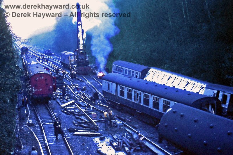 A number of accidents have occurred near Haywards Heath.  This is Copyhold Junction on Monday 18.12.1972 as breakdown trains cleared the wreckage from a collision that occurred on 16 December 1972 when two northbound Victoria trains came together at the point where the Up Through line and Up Local line merged near Copyhold Bridge.  The trains were lightly loaded and although there was extensive damage there were no serious injuries.  The incident was caused by the train on the local line passing a red signal.  This is the view south.   Eric Kemp retains all rights to this image.