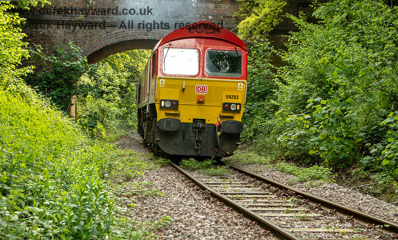 59203 leaves Ardingly, passing under Rivers Farm accommodation bridge as it heads for Copyhold Junction.  Adrian Backshall retains all rights to this image.