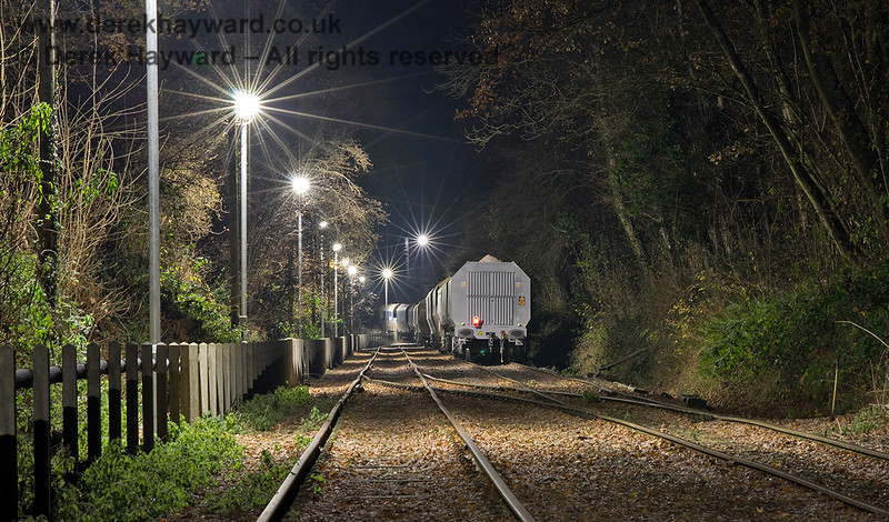 Newly arrived fully loaded wagons standing on the approach to the Ardingly plant.  Adrian Backshall retains all rights to this image.