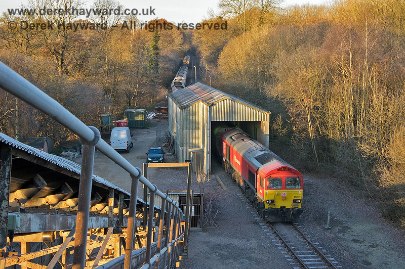 59203 and train passing through the dropper shed at Ardingly, as seen from the top of the conveyor.  Adrian Backshall retains all rights to this image.