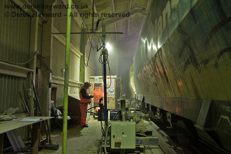 Inside the dropper shed as the train runs slowly through and discharges.  The wagon door unlocking mechanism is in the foreground.  Adrian Backshall retains all rights to this image.