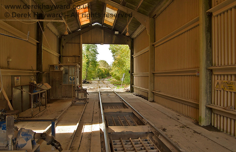 Inside the dropper shed, looking west.  The small section of narrow track on the left carries two little motorised unlocking tools that unlock the wagon doors.  They move along their track as required.  Adrian Backshall retains all rights to this image.