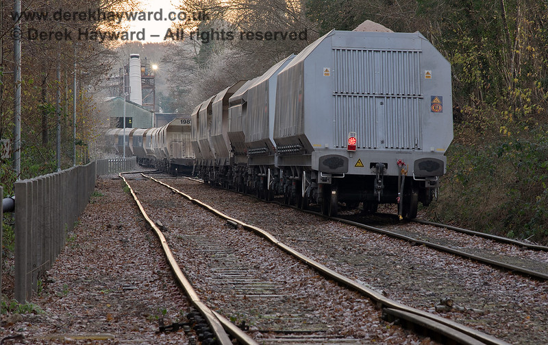 Shunting wagons at sunrise.  The train is split in half for unloading and subsequently has to be reformed.  Adrian Backshall retains all rights to this image.