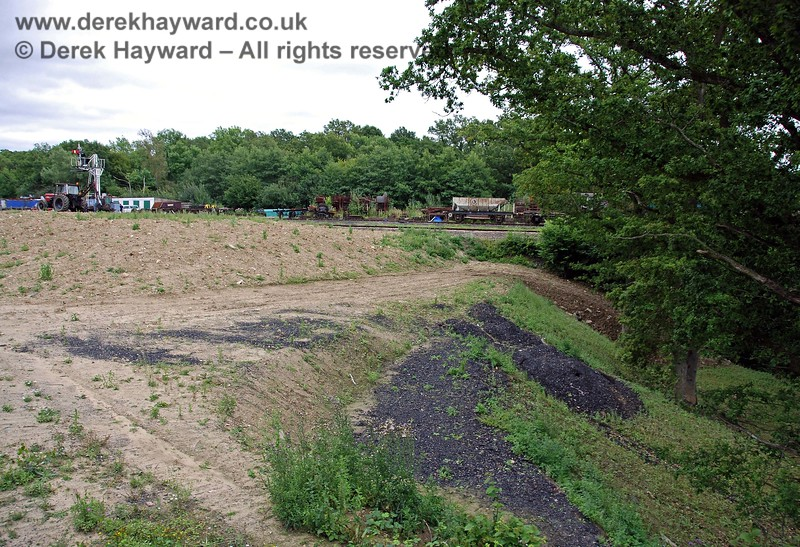 The boundary between the inert spoil and the wooded hollow.  Work is still in progress to form and shape this area. 15.08.2009