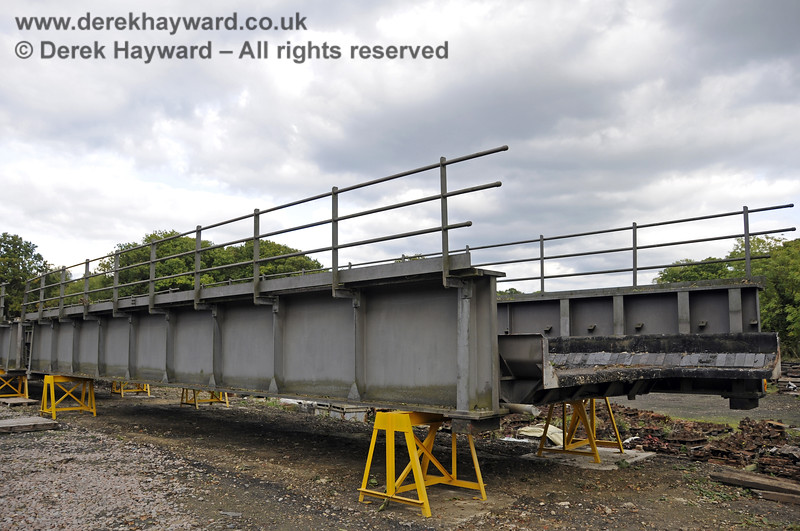 In October 2013 bridge sections were delivered to the down yard at Horsted Keynes which might, in the future, be used to span the gap on the Ardingly Branch west of Horsted Keynes Station.  06.10.2013  9773