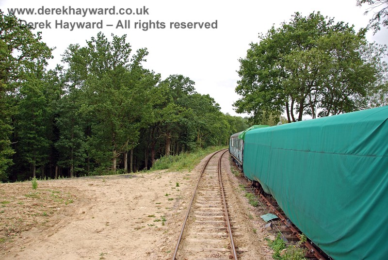 The end of the triangle is on the left as the line to Ardingly continues to curve westwards past disused stock. 15.08.2009