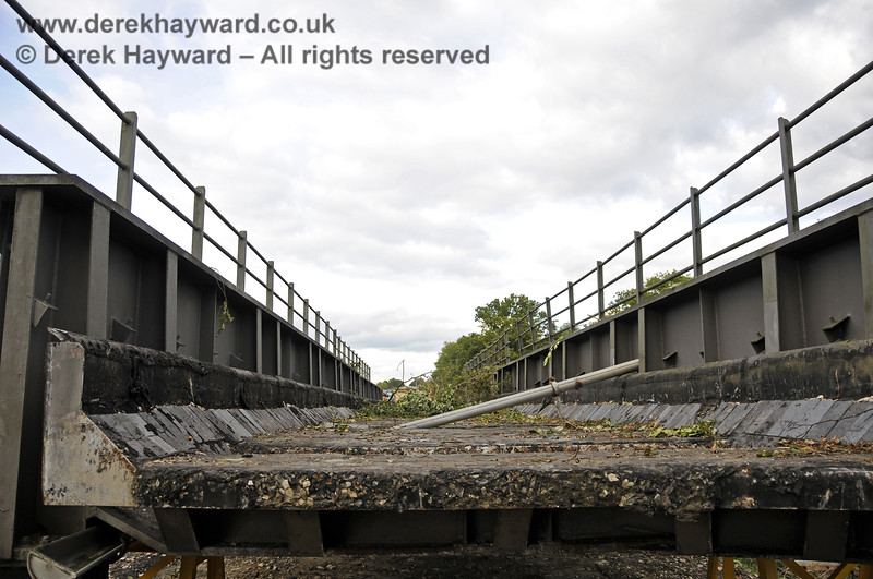 In October 2013 bridge sections were delivered to the down yard at Horsted Keynes which might, in the future, be used to span the gap on the Ardingly Branch west of Horsted Keynes Station.  06.10.2013  9772