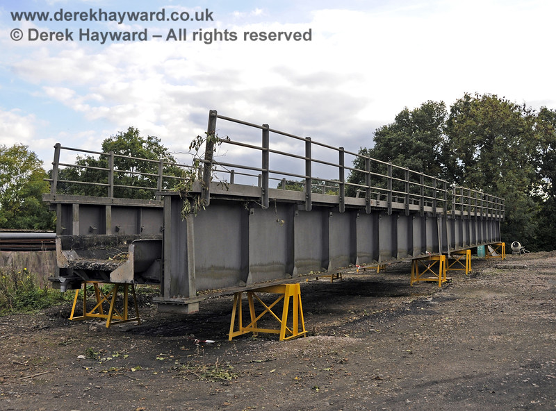 In October 2013 bridge sections were delivered to the down yard at Horsted Keynes which might, in the future, be used to span the gap on the Ardingly Branch west of Horsted Keynes Station.  06.10.2013  9774