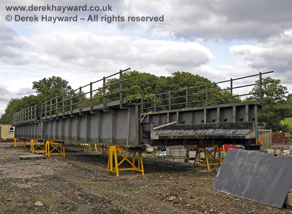 In October 2013 bridge sections were delivered to the down yard at Horsted Keynes which might, in the future, be used to span the gap on the Ardingly Branch west of Horsted Keynes Station.  06.10.2013  9771
