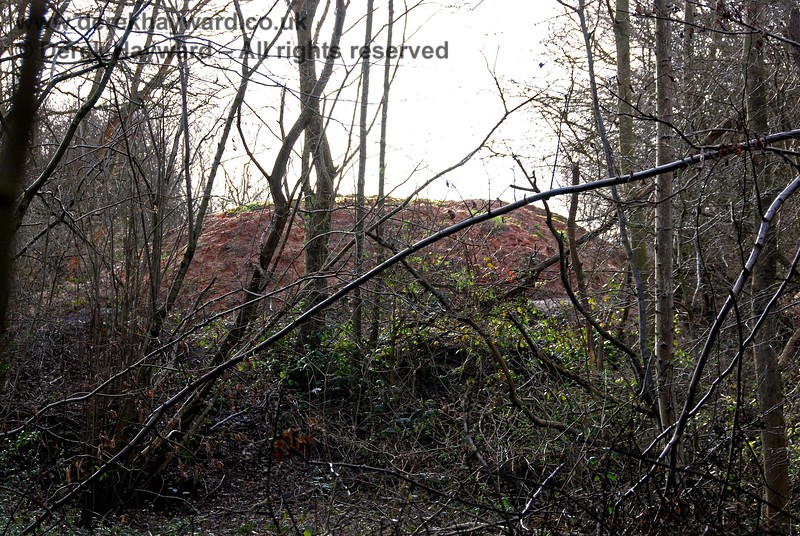 Taken from the same position, but with a long lens, the pile of material in the Hanson Yard blocks the trackbed (this is Hanson property and is OUT OF BOUNDS).