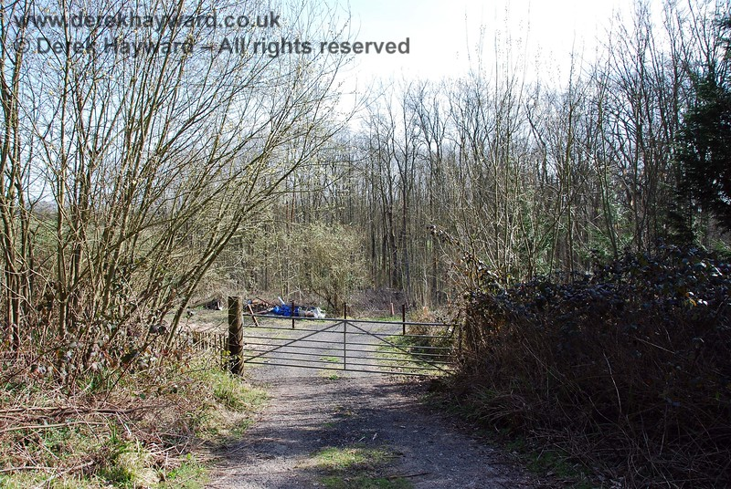 The access from the road passes directly across the trackbed and enters private land to the south of the line through this gate.  This would be a farm crossing if the line were in use.