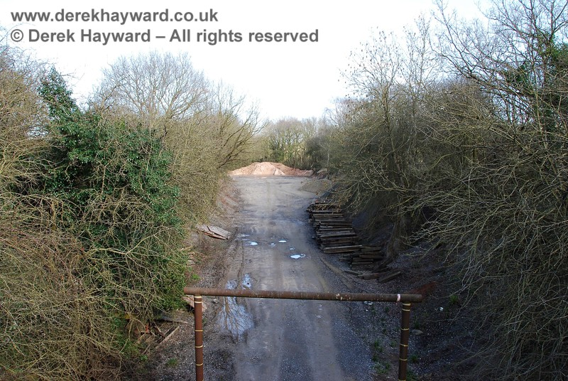 This view looks back east at the same pile of material from the bridge at Ardingly Station.  It can be seen that there is little material stored in the eastern end of the Hanson premises.  Ardingly Station and the Hanson plant are covered in the next gallery.