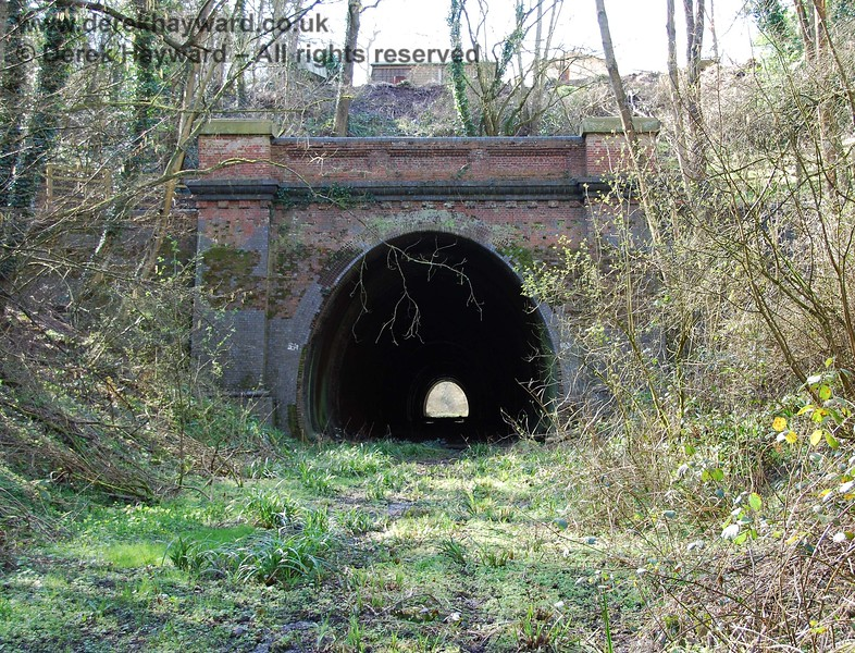 Taken from the same point, but with a longer lens, this picture shows the eastern portal.  The tunnel appears generally in good condition.  Please note that the tunnel is not owned by the Bluebell Railway and is private property.  It is strictly OUT OF BOUNDS.