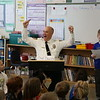 "HOLLY PELCZYNSKI - BENNINGTON BANNER <br /> Bennington Police Chief Paul Doucette cheers while answering a difficult question read by third-grader Nolan Lampron  while at Monument Elementary School on Friday morning during a roaring game of ""Are you smarter than a third grader?"""