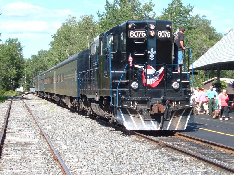 Geep 6076 departs Thendara for Utica with a full train. August 2006