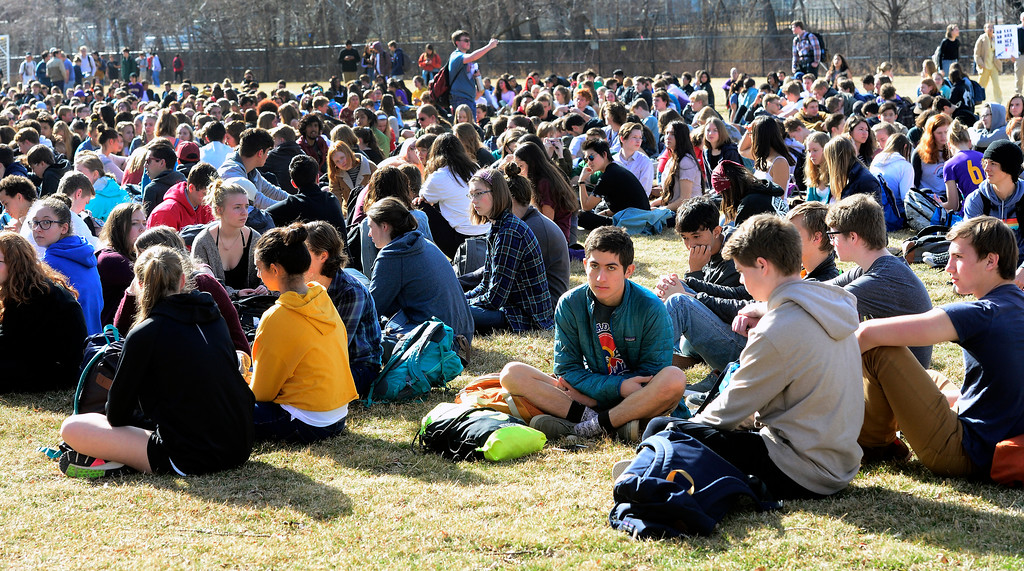 . Students sit in silence during a walkout to protest gun violence at Boulder High School on Wednesday morning.  For more photos go to dailycamera.com Paul Aiken Staff Photographer March 14, 2018.