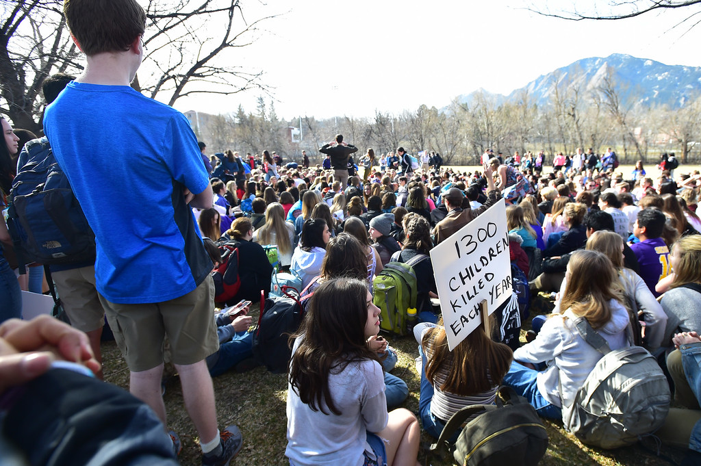 . Students listens to speakers during a walkout to protest gun violence at Boulder High School on Wednesday morning.  For more photos go to dailycamera.com Paul Aiken Staff Photographer March 14, 2018.