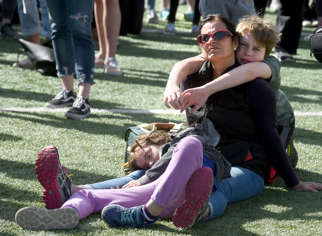 . Guacra Andrade listens to speakers with her children, Daphne Gartner, and Dylan Gartner,  at Fairview High School in Boulder. Students at schools across Boulder County and Broomfield walked out of class around 10 this morning as they took part in the nationwide protest of gun violence on the one-month anniversary of the massacre at a high school in Parkland, Fla., that left 17 dead. Cliff Grassmick  Photographer  March 14, 2018