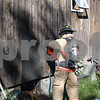 Hampstead Firefighters checking out side wall for fire.