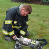 Salem Firefighter changing out air pack