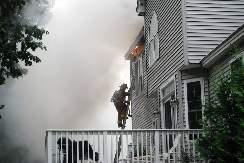 Windham Firefighter going up to vent windows