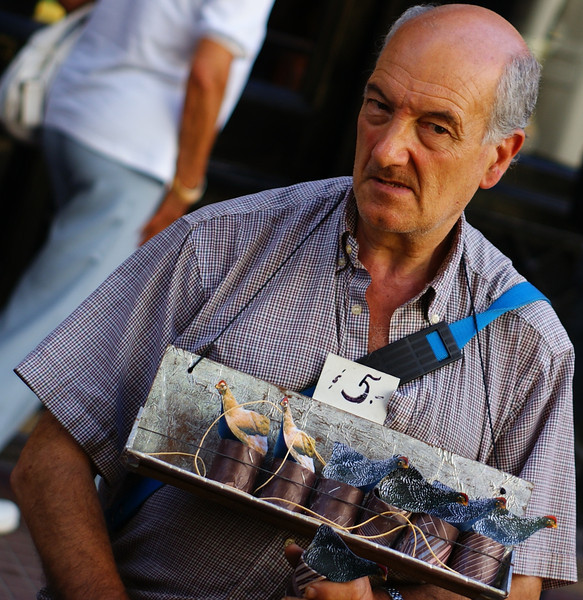 "<a href=""http://nomadicsamuel.com/photo-blog/street-vendor-buenos-aires-argentina-travel-photo"">http://nomadicsamuel.com/photo-blog/street-vendor-buenos-aires-argentina-travel-photo</a> : Today's travel photo is of  a Porteño street vendor selling trinkets at the popular San Telmo Sunday market in Buenos Aires, Argentina."
