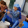 Today's daily travel photo is of a lady dressed entirely in blue preparing to perform at the Sunday market in San Telmo - Buenos Aires, Argentina.