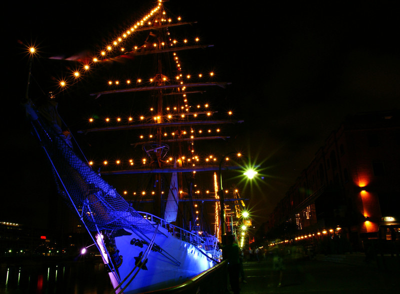 Today's daily travel photo is of a ship docked at night in the downtown area of Buenos Aires, Argentina.