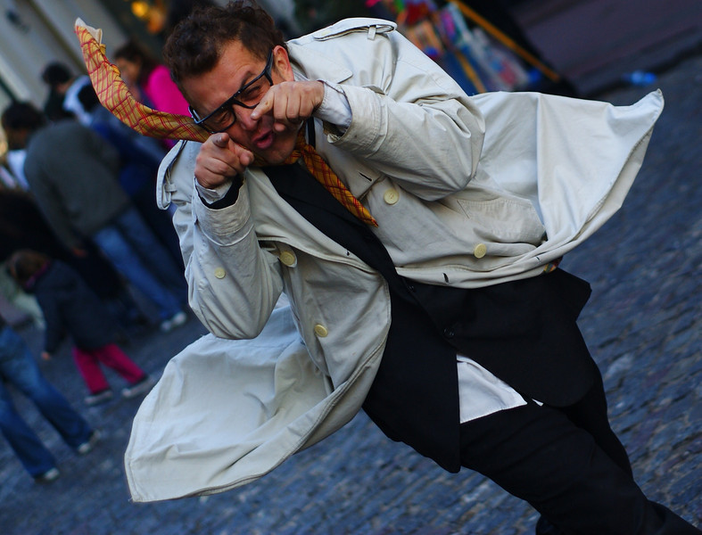 """A performance artist/street performer strutting his stuff at the Sunday market in San Telmo - Buenos Aires, Argentina.  This is a travel photo from Buenos Aires, Argentina. <a href=""""http://nomadicsamuel.com"""">http://nomadicsamuel.com</a>"""