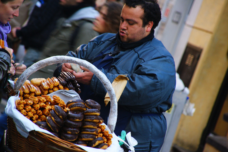 """An animated street vendor sells churros and donuts around the San Telmo barrio - Buenos Aires, Argentina.  This is a travel photo from Buenos Aires, Argentina. <a href=""""http://nomadicsamuel.com"""">http://nomadicsamuel.com</a>"""